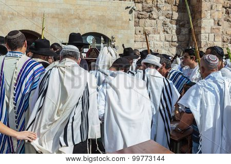 JERUSALEM, ISRAEL - OCTOBER 12, 2014: Morning autumn Sukkot. The area in front of Western Wall of  Temple filled with people. Crowd of faithful Jews wearing prayer shawls