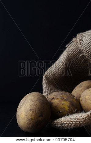 Potatoes Spilling From Hessian Sack