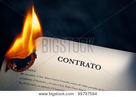 Closeup Of Contract In Spanish Burning On Fire