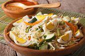 Indonesian salad gado-gado with peanut sauce close-up on a plate. Horizontal poster