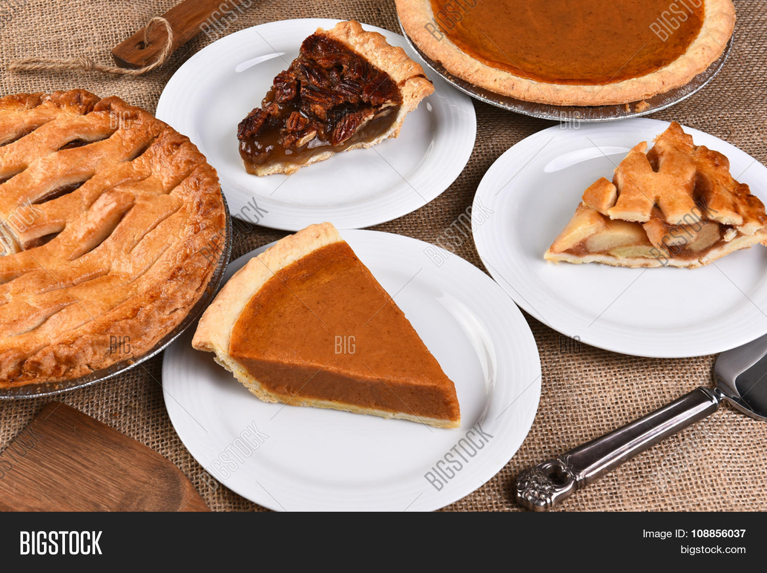 High angle view of whole pies and plates with slices. Traditional Thanksgiving desserts include & High Angle View Whole Pies Plates Image u0026 Photo | Bigstock