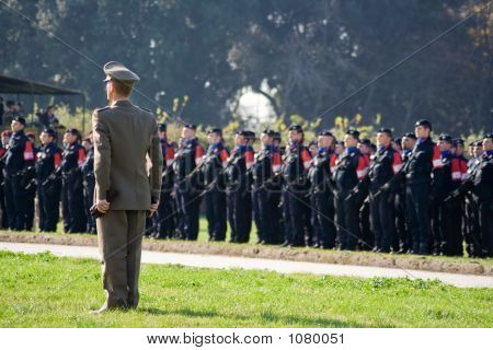 Military Officer Standing Ahead Of Troops