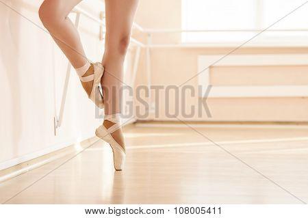 Legs of young ballerinas.