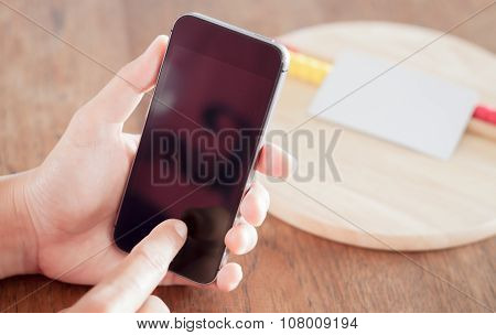 Smart Phone In A Woman's Hand