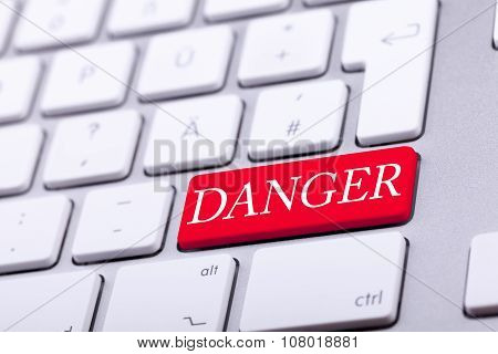 High End Aluminium Keyboard With Danger Word In Red On It