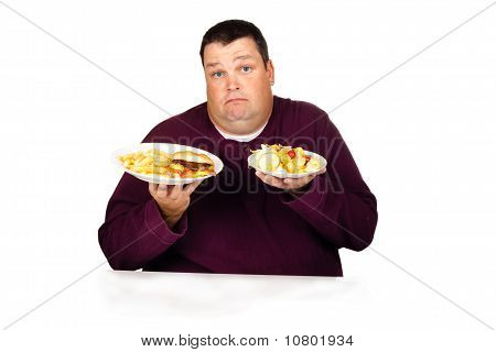 Man Thinking What To Eat Between A Cheeseburger Meal And A Salad
