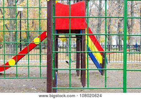 Empty Children's Playground And A Slide In The Park