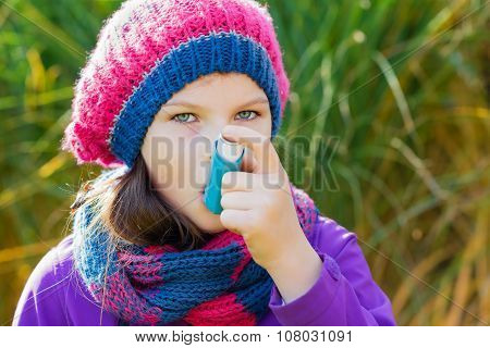 Girl Using Inhaler On A Autumn Day