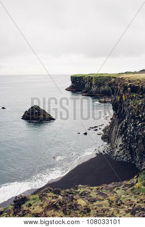 Black Sand Beach And Cliff In Iceland
