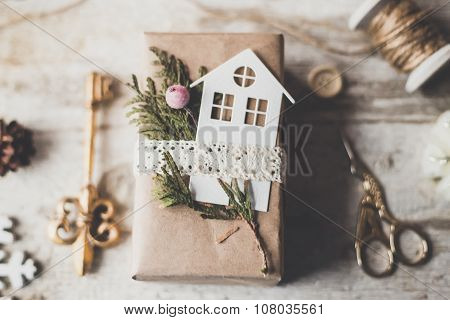 Cozy vintage toned winter holidays Christmas Composition with Gifts Boxes and Balls, Pine Cones Wood