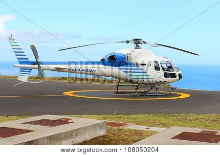 EPERON, REUNION ISLAND, FRANCE - NOVEMBER 7, 2015: The Eurocopter 355N double turbines on a Helilagon heliport. Helicopter for 6 passengers, max. weight: 2540 kg, max. speed: 278km/h