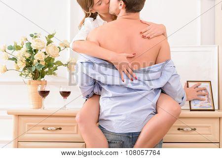 Seductive female housekeeper kissing