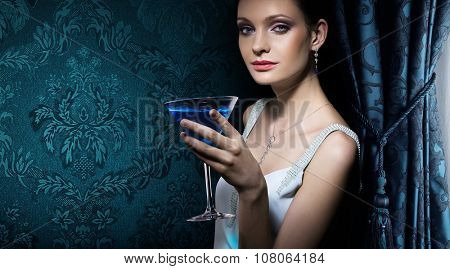 Portrait of noble beautiful woman with martini glass on damask wallpaper background. Banner for interior design studio.