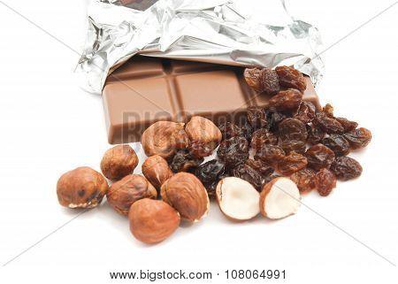 chocolate hazelnuts and some raisins on white poster