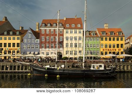 COPENHAGEN, DENMARK-SEPT 03, 2015: Old ship in front of Nyhavn is a 17th-century waterfront, canal and entertainment district in Copenhagen, Denmark.