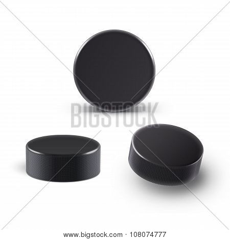 Hockey puck isolated on white with shadow