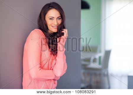 Beautiful woman at home smiling