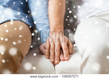 people, homosexuality, same-sex marriage, gay and love concept - close up of happy male gay couple holding hands over snow effect poster