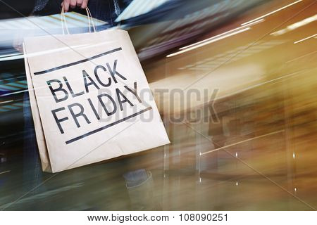 Black Friday paperbag carried by modern customer