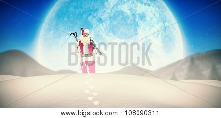 Santa claus holding ski and ski poles against quaint town with bright moon
