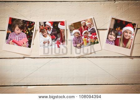 Instant photos on wooden floor against shocked little boy looking at gift