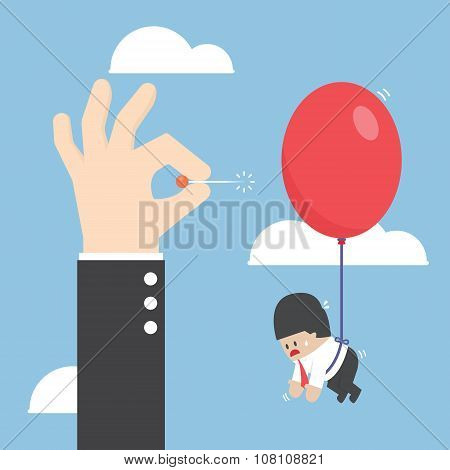Businessman Hand Pushing Needle To Pop The Balloon Of His Rival