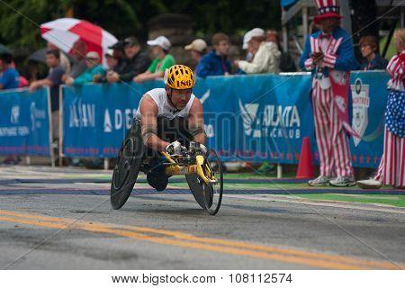 Wheelchair Athlete Speeds Toward Finish Line Of Peachtree Road Race