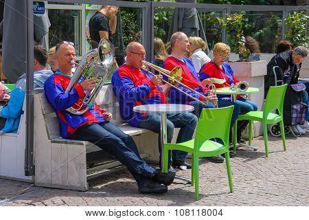 Street Performance Of Musical Group De Muggenblazers In Zandvoort, The Netherlands