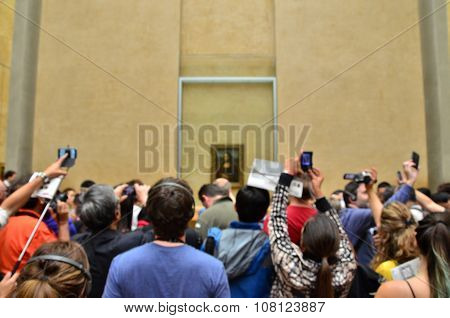 Paris, France - May 13, 2015: Visitors Take Photos Of Leonardo Davinci's