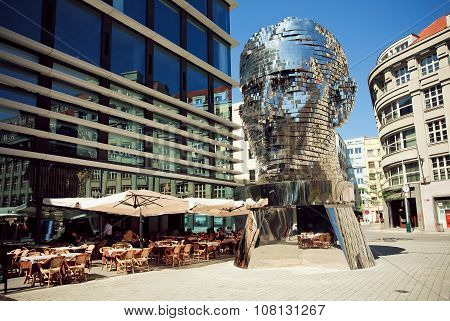Outdoor Cafe Near  Famous Artist David Cerny's Sculpture Metalmorphosis In Giant Head Form