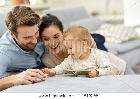 Parents enjoying playing with baby girl