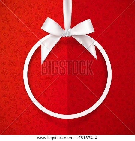 White holiday round frame with bow and silky ribbon at red Christmas doodle folded paper background