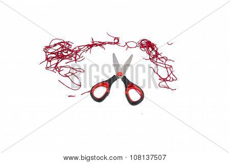 Scissors and thread  on white