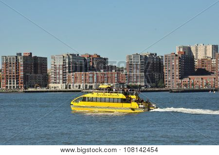 NEW YORK, NY - OCT 10: The New York Water Taxi on the Hudson River in New York, as seen on Oct 10, 2015. It is one of several private operators of ferries, sightseeing boats, and water taxis in the Port of New York and New Jersey.