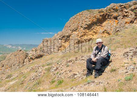 Lonely hiker having short rest on Kara-dag natural reserve in Eastern Crimea