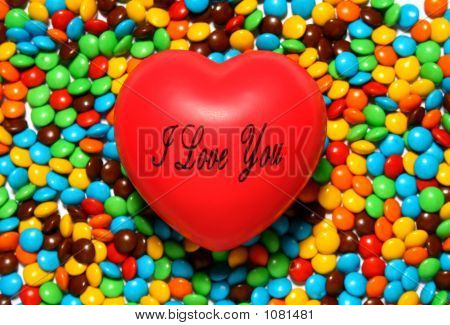 Soft Red Heart Over Candy Background