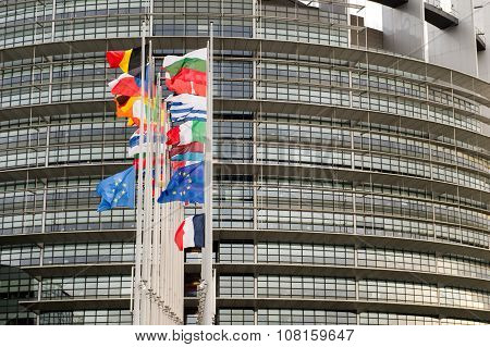 European Union Flags and France flag flies at half-mast in front of the European Parliament building following an terrorist attack in Paris