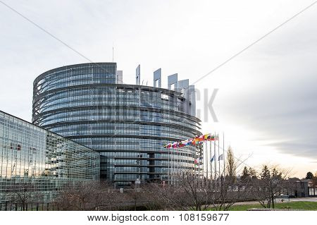 STRASBOURG FRANCE - 14 Nov 2015: European Union Flags and France flag flies at half-mast in front of the European Parliament building following an terrorist attack in Paris