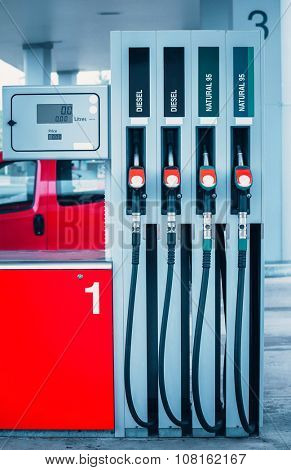 Fuel guns at gas station with petrol and diesel fuel for automobile transport