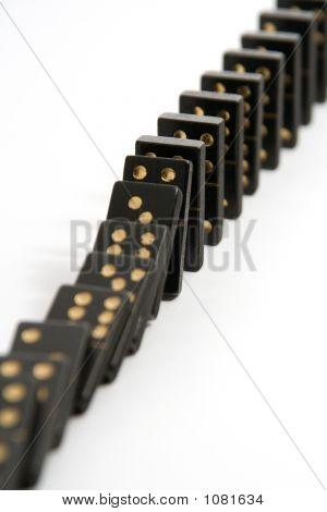 Black Dominoes Falling Down In A Line