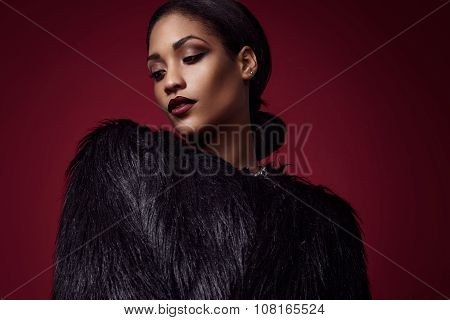Woman With Strobing Skin And Bright Lips