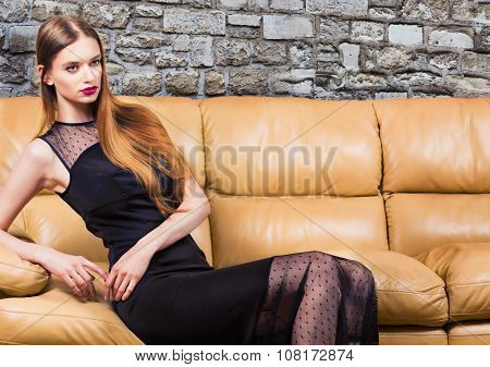 Woman In Classic Black Dress In Luxury Interior.
