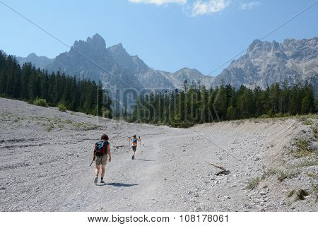 Woman And Kid Walking On Talus In Wimbachtal Valley.
