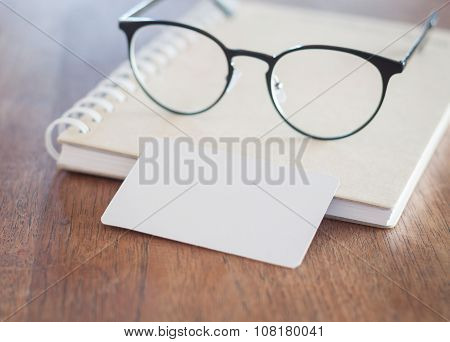 Blank Business Cards And Eyeglasses On Wooden Table