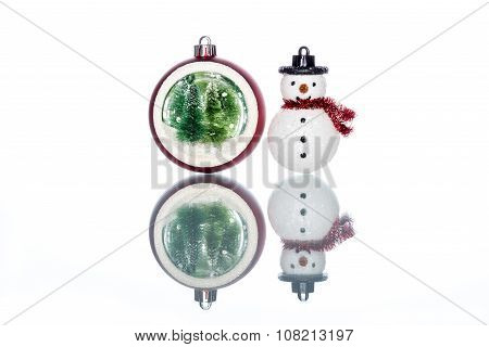 Snowglobe With Christmas Tree Inside With Snowman On White Background