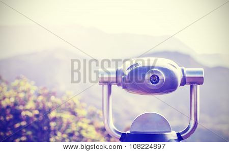 Vintage Toned Monocular Pointed At Horizon, Shallow Depth Of Field.