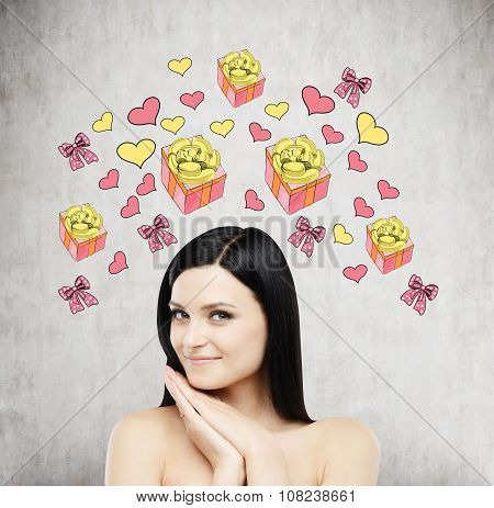 A Brunette Beautiful Woman Is Dreaming About The Gift. Gift And Heart Icons Are Drawn On The Concret