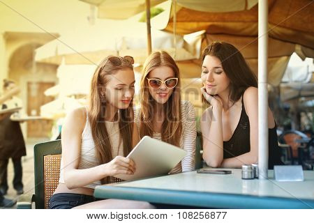 Three girls at the cafe