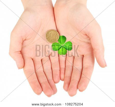 Clover leaf and euro coin in hand isolated on white