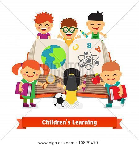 Kids learning together from big encyclopedia book